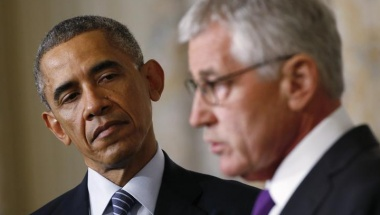 U.S.  President Obama listens to Defense Secretary Chuck Hagel after the president announced Hagel's resignation at the White House in Washington