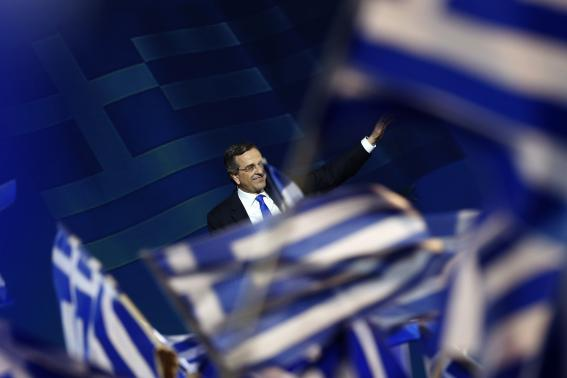 Greek Prime Minister and leader of the conservative New Democracy party Samaras waves to supporters during a campaign rally in Athens